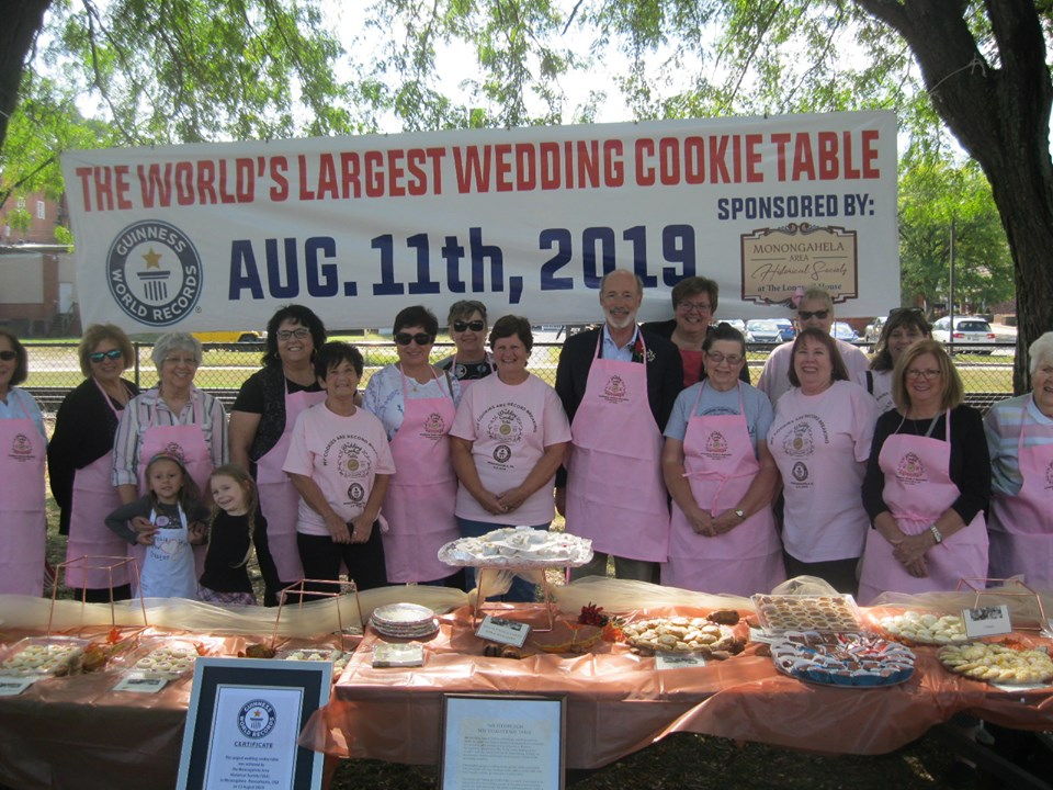 Gov Tom Wolfe with cookie bakers